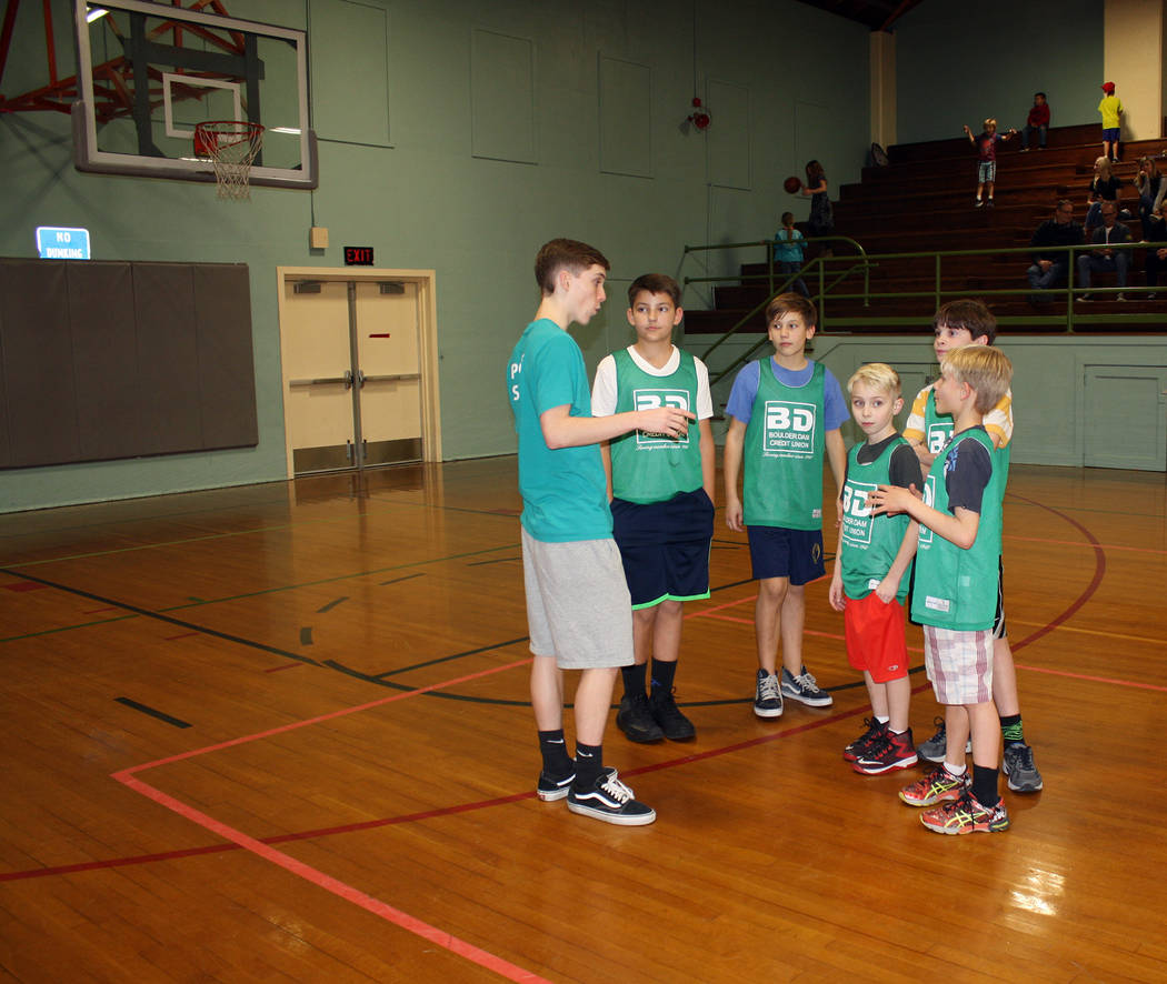 Kelly Lehr Billy Ferrence, left, grandson of the late Bill Ferrence, who headed the Boulder Dam Credit Union for 37 years, coaches the city's recreation department's youth basketball team sponsore ...