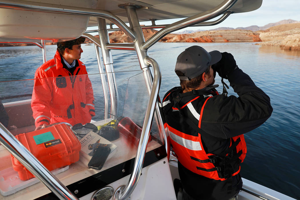 Andrea Cornejo/Las Vegas Review-Journal Southern Region Supervising Biologist Joe Barnes, 39, right, and environmental protections specialist Ben Smith, 30, scan the sky for bald eagles at Lake Me ...