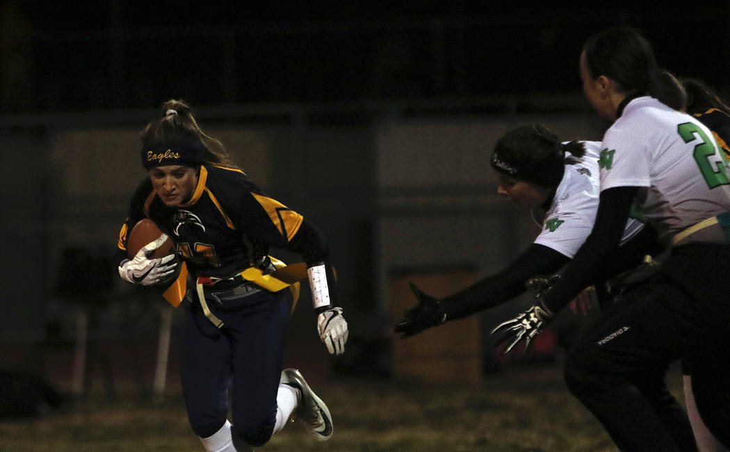 Tristin Phelps/Boulder City Review Boulder City High School junior Bailey Willis runs the ball down the field for a 10-yard gain on Jan. 25. The Lady Eagles lost to Virgin Valley 33-0.
