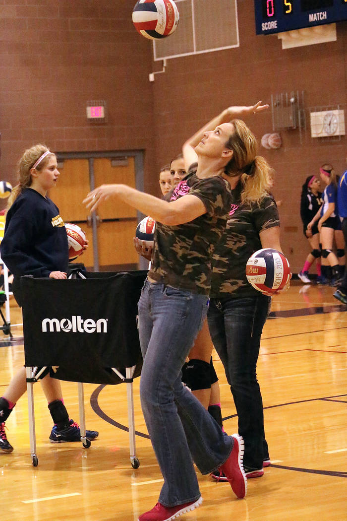 Cherise Hinman After 20 seasons as head varsity girls volleyball coach, Cherise Hinman, seen demonstrating proper technique, has decided to retire.