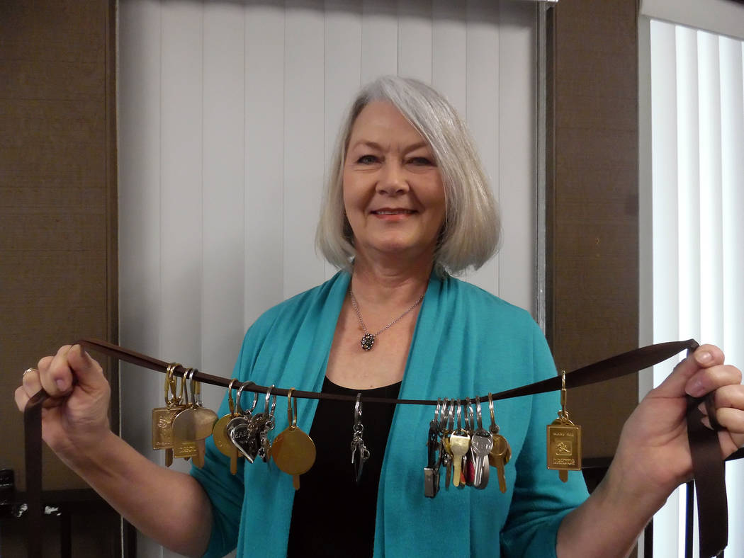 Hali Bernstein Saylor/Boulder City Review Dawn Walker, an independent senior sales consultant for Mary Kay, shows off the 18 car keys she earned for her business achievements.