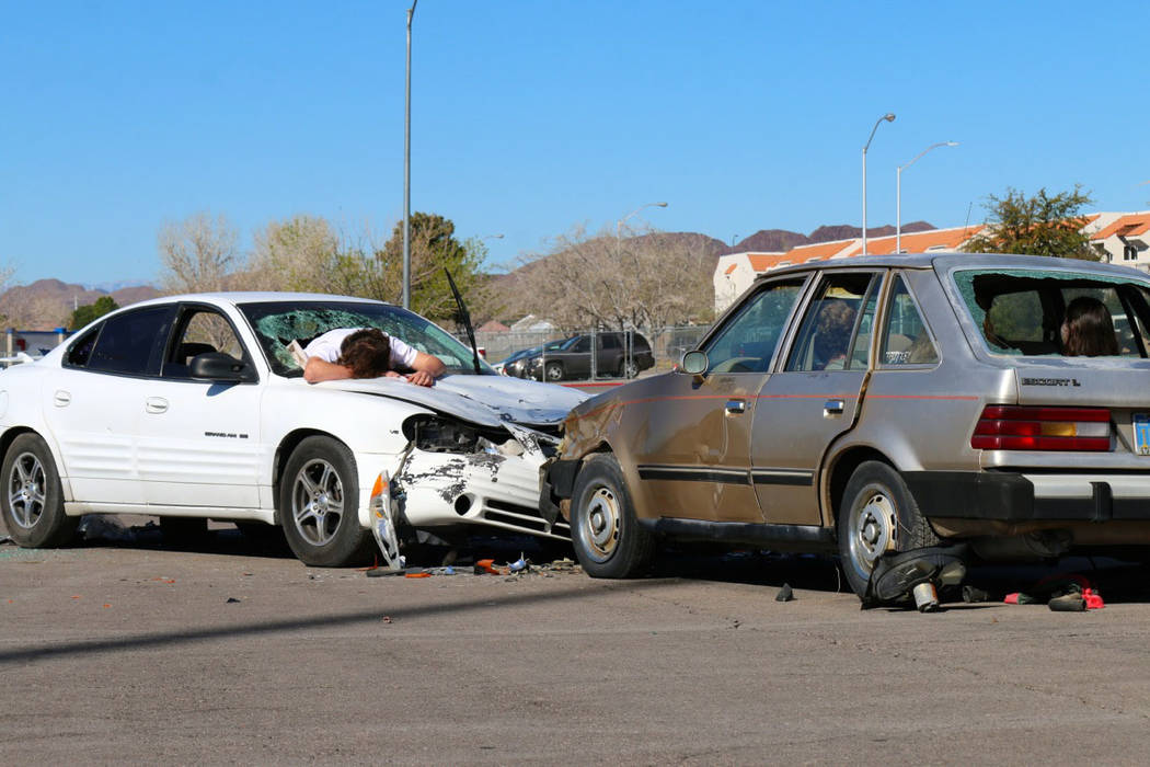 Laura Hubel/Boulder City Review A head-on collision caused by a drunk driver was key to the Every 15 Minutes program presented at Boulder City High School on March 9. Students witnessed their peer ...