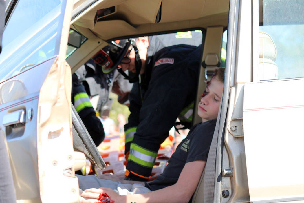 Laura Hubel/Boulder City Review Kenon Cowley, a passenger in the car that was hit by a drunk driver during Boulder City High School's Every 15 Minutes program on March 9 that featured a realistic  ...