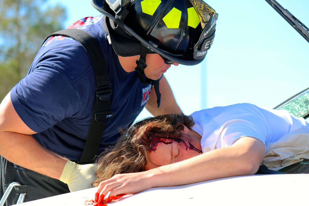 Laura Hubel/Boulder City Review Boulder City Fire Department responded to the scene of a deadly crash as part of the Every 15 Minutes program at Boulder City High School on March 9, 2017. Here, st ...