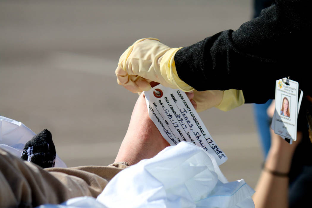 "Laura Hubel/Boulder City Review Clark County coroner's office places a toe tag on Boulder City High School student Shaun Jones, who ""died"" at the scene of a drunk driving crash as part of the scho ..."