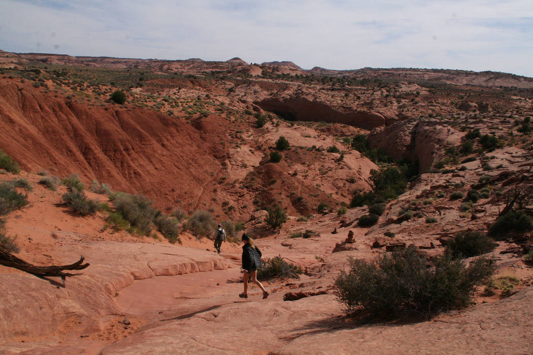 Photo courtesy Deborah Wall Hikers descend down the slick rock from the trailhead at Grand Staircase-Escalante National Monument in Utah.