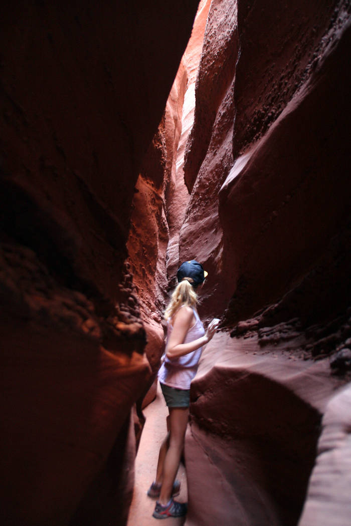 Photo courtesy Deborah Wall Hikers have to sometimes walk sideways to continue into the upper Spooky Gulch slot canyon in Grand Staircase-Escalante National Monument in Utah.