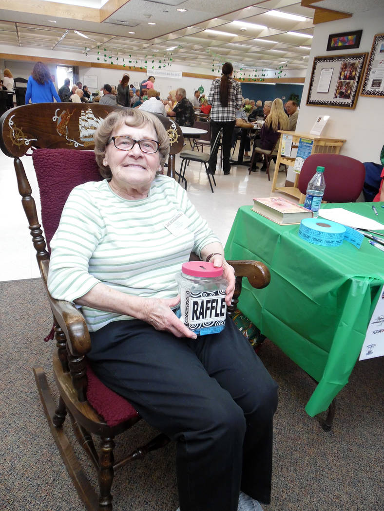Hali Bernstein Saylor/Boulder City Review Senior Center of Boulder City board member Mae Kahl does double duty selliing raffle tickets while rocking to help raise funds for the center's Meals on W ...