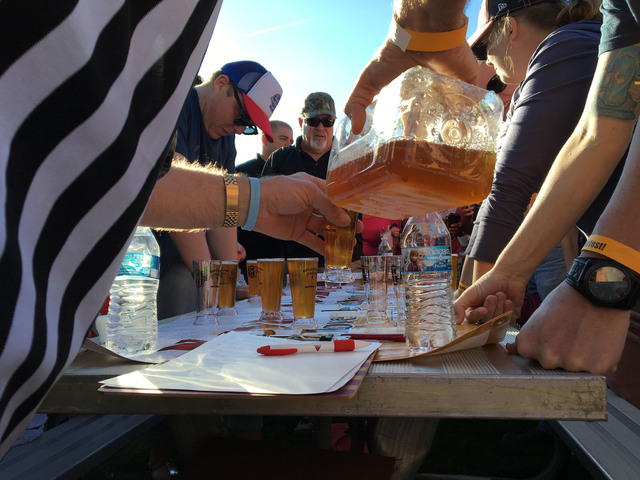 File photo The referee of the beer games pours beer for contestants participating in a chugging relay at the 2016 Boulder City Beer Fest. The fifth annual event returns to Wilbur Square Park on Sa ...