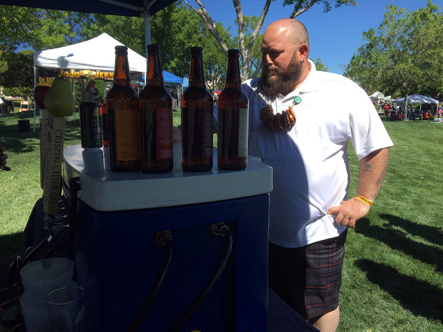 File photo Jeremy Evans of Boulder City samples Crispin ciders at the last year's Boulder City Beer Fest. This year's event begins at 1 p.m. Saturday and will be held at Wilbur Square Park.