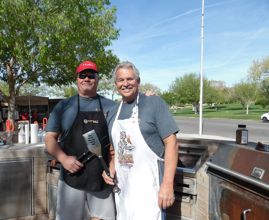 Hali Bernstein Saylor/Boulder City Review Andy Anderson, left, and Dale Ryan, members of the Rotary Club of Boulder City, manned the barbecue during the Senior Center of Boulder City's Rock, Roll  ...