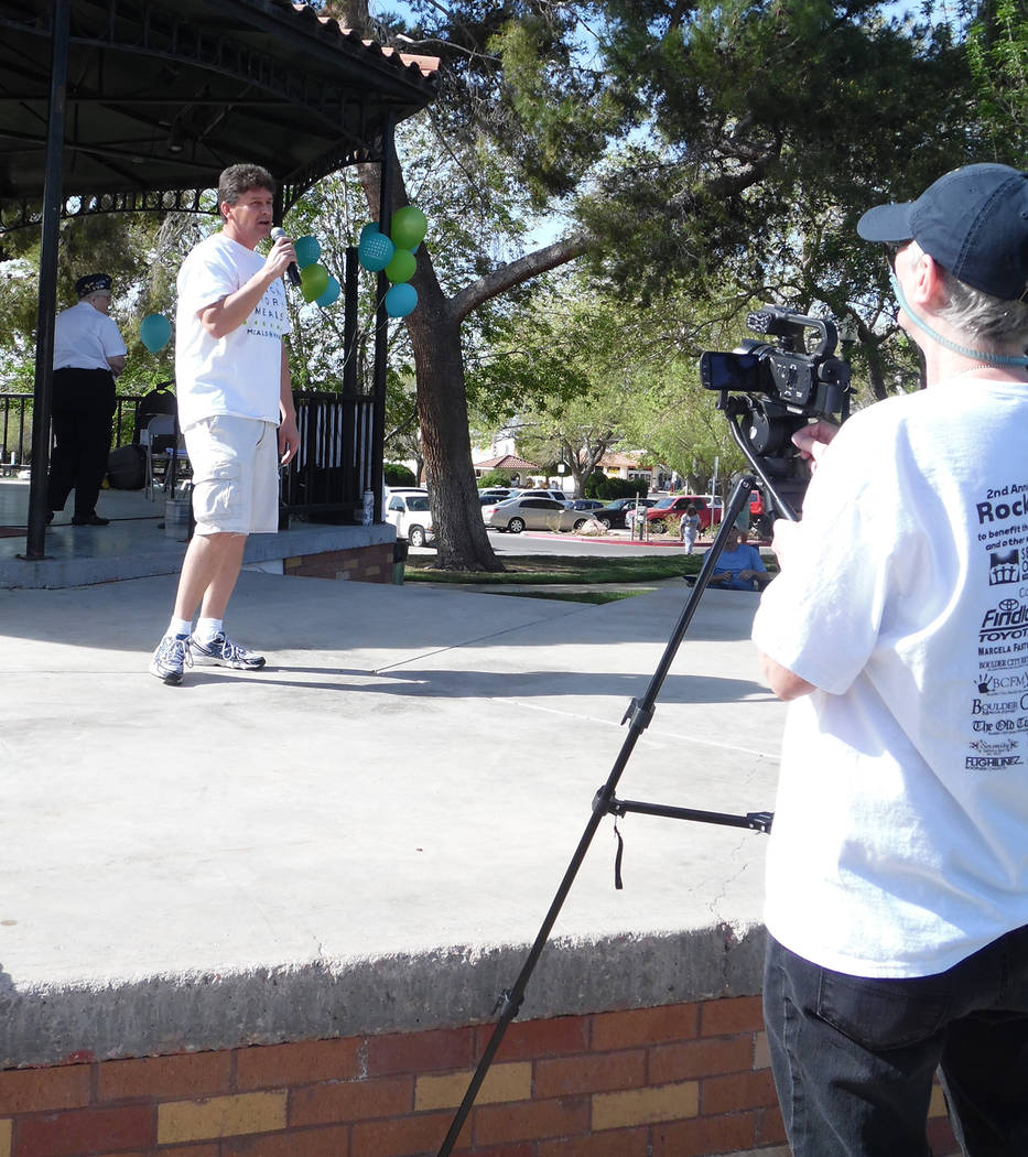 Hali Bernstein Saylor/Boulder City Review Boulder City Mayor Rod Woodbury offers some remarks about the importance of the Meals on Wheels program during opening ceremonies for the Rock, Roll & ...