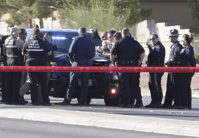 File Police investigate an officer-involved shooting after a Nevada Highway Patrol trooper fatally shot Javier Munoz of Arizona on Oct. 19 after a car chase in Henderson.