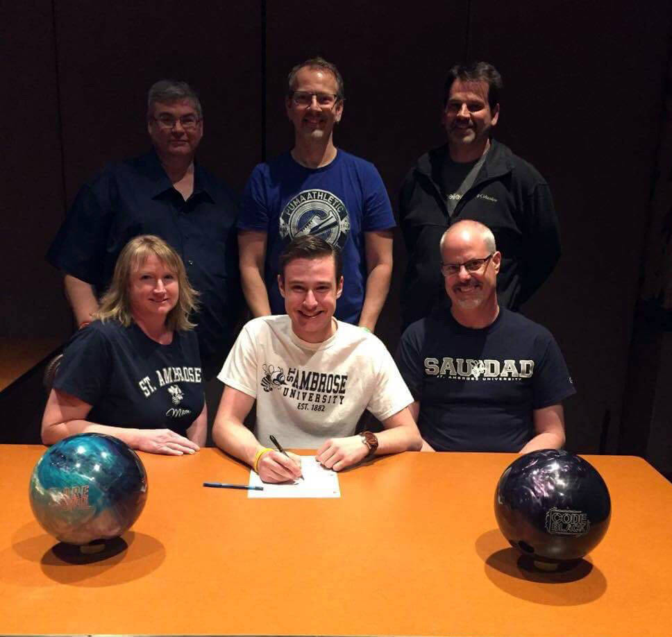 Kayla Crawford/St. Ambrose University  Teagan Smale, center, with his parents, Jamie and Don Smale, recently signed a letter of intent to attend and bowl for St. Ambrose University in Davenport, I ...