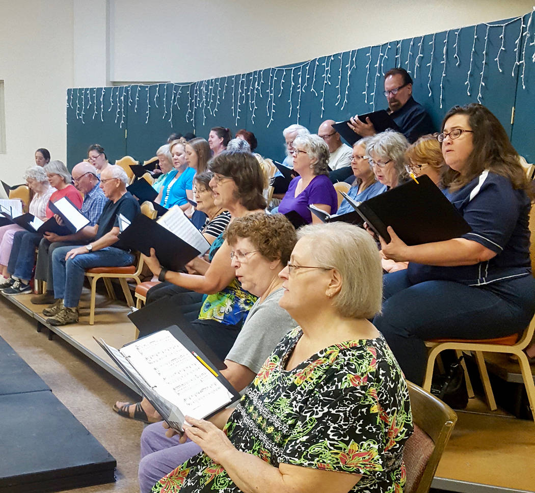 Courtesy Members of the Red Mountain Choir rehearse for an upcoming performance. The ensemble will sings songs made famous by Carole King and James Taylor during concerts Friday and Saturday at th ...
