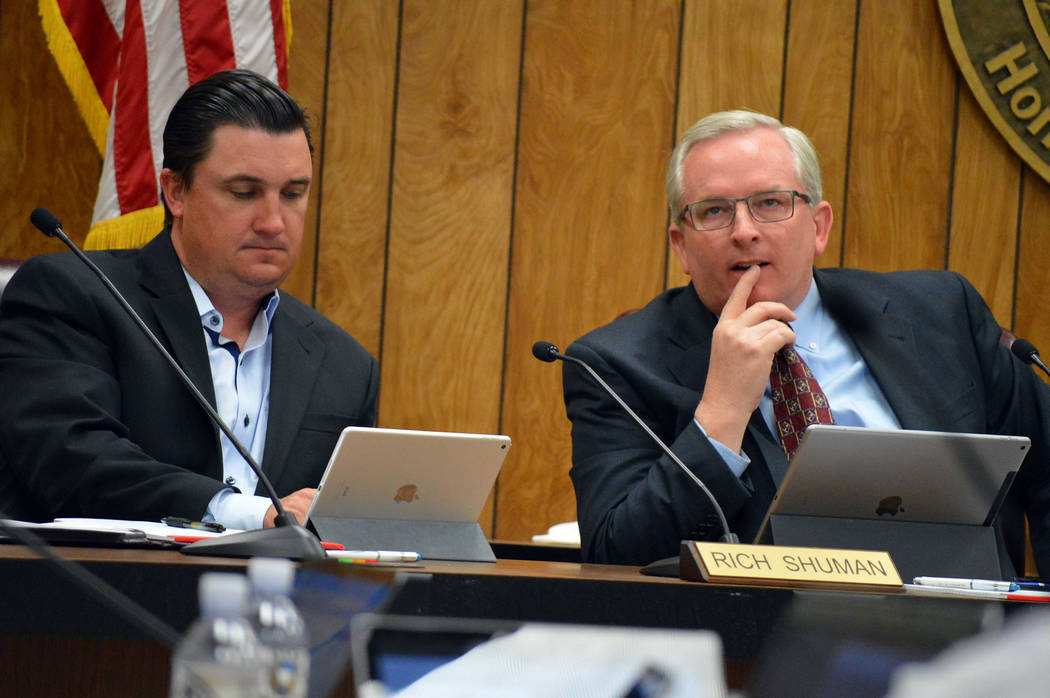 Celia Shortt Goodyear/Boulder City Review City Councilmen Rich Shuman, left, and Cam Walker, watch a presentation during the City Council meeting on Tuesday.