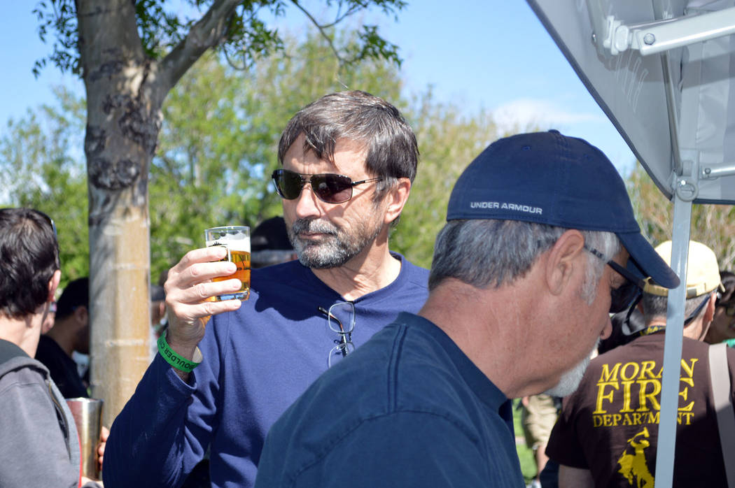 Celia Shortt Goodyear/Boulder City Review Lorne Caddick examines the beer he is about to sample at Saturday's beer fest held in Wilbur Square Park.