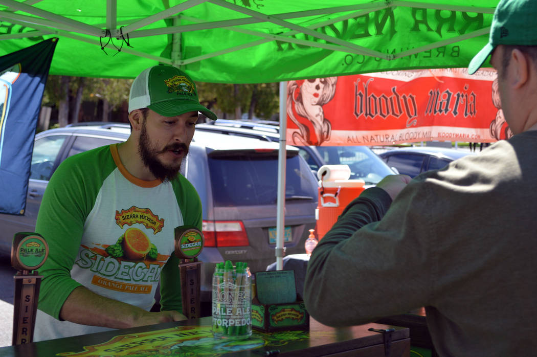 Celia Shortt Goodyear/Boulder City Review Matt Reiser of Sierra Nevada pours a sample for a guest at the 2017 Boulder City Beerfest, held Saturday in Wilbur Square Park in downtown Boulder City.