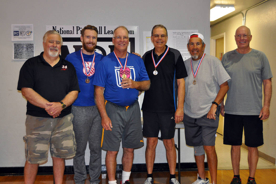 Courtesy Roger Hall, Boulder City Park and Recreation Department director, far left, congratulates he point leaders from the second day of the Mix-Up/Pick-Up Pickeball tournament fundraiser from l ...