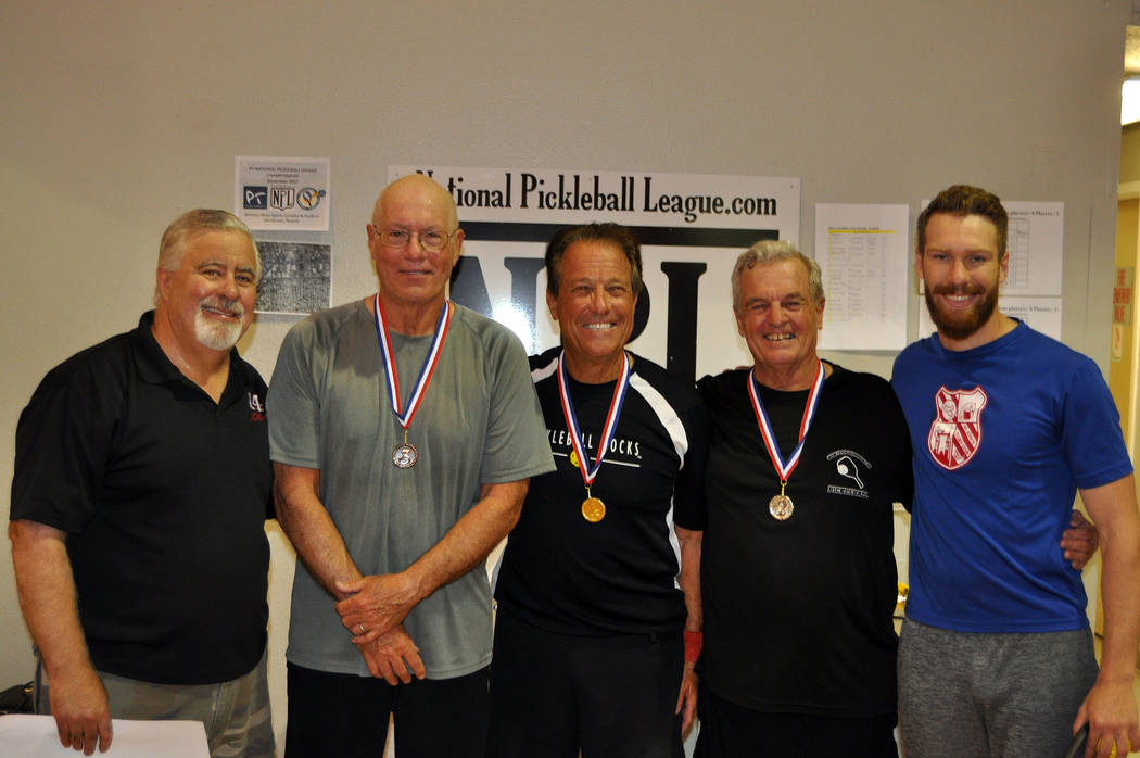 Courtesy Roger Hall, director of Boulder City Park and Recreation Department, congratulates winners from the Mix-Up/Fix-Up Pickleball tournament fundraiser, from left, Duane Weed, third place with ...