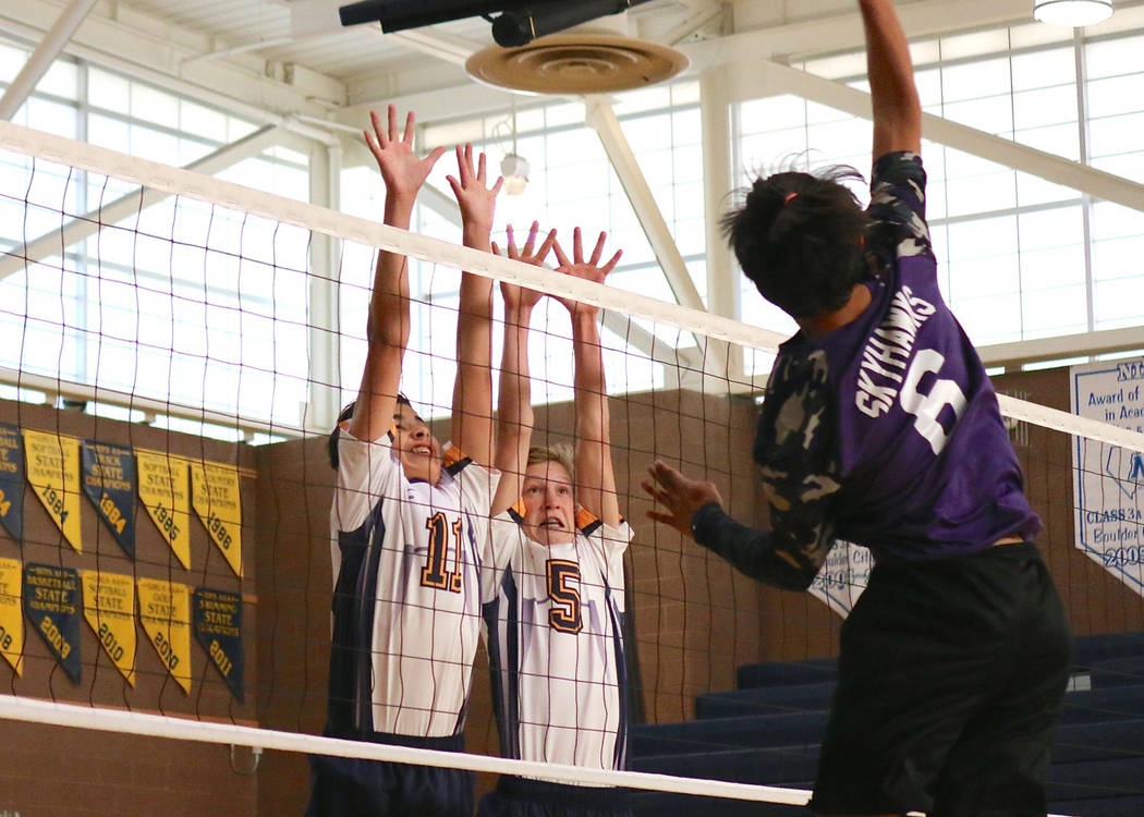 Laura Hubel/Boulder City Review Dylan Mullins, left, and Austin Morris, members of Boulder City High School's new freshman boys volleyball team, defend the net during the Eagles' victory Monday ag ...