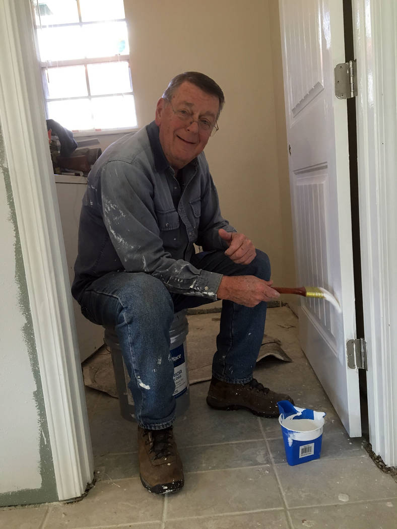 Rev. Sandy Johnson Bruce Benke paints a door at the Habitat for Humanity rebuild house in Louisiana. Benke was one of 10 people from Boulder City United Methodist Church who traveled there to help ...