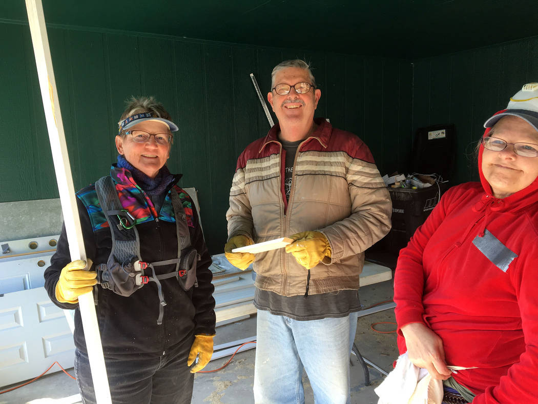 Rev. Sandy Johnson Kathleen Wood, left, Chuck Lennon and Leesha Nush work on repairs for a house in Louisiana last year that was damaged by a 2016 flood.