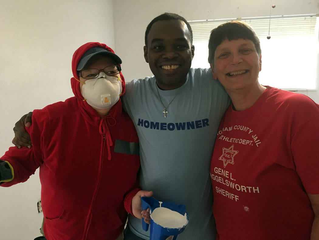 Rev. Sandy Johnson Jason Hunt, center, thanks Leesha Nush, left, and Kay Benge for the repair work they and Habitat for Humanity did to his house in Louisiana. His home was severely damaged by a f ...