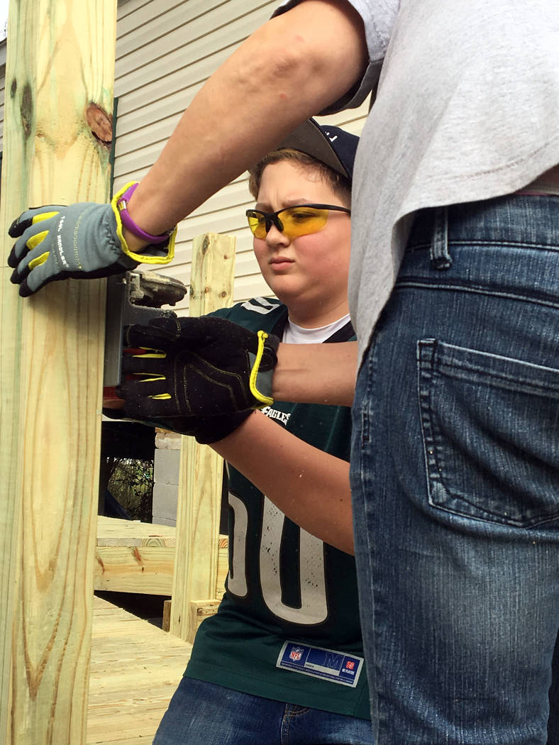 Rev. Sandy Johnson Cameron Johnson constructs an 85-foot-long wheelchair ramp at a house in Louisiana, one of three projects he and others from Boulder City United Methodist Church participated in ...