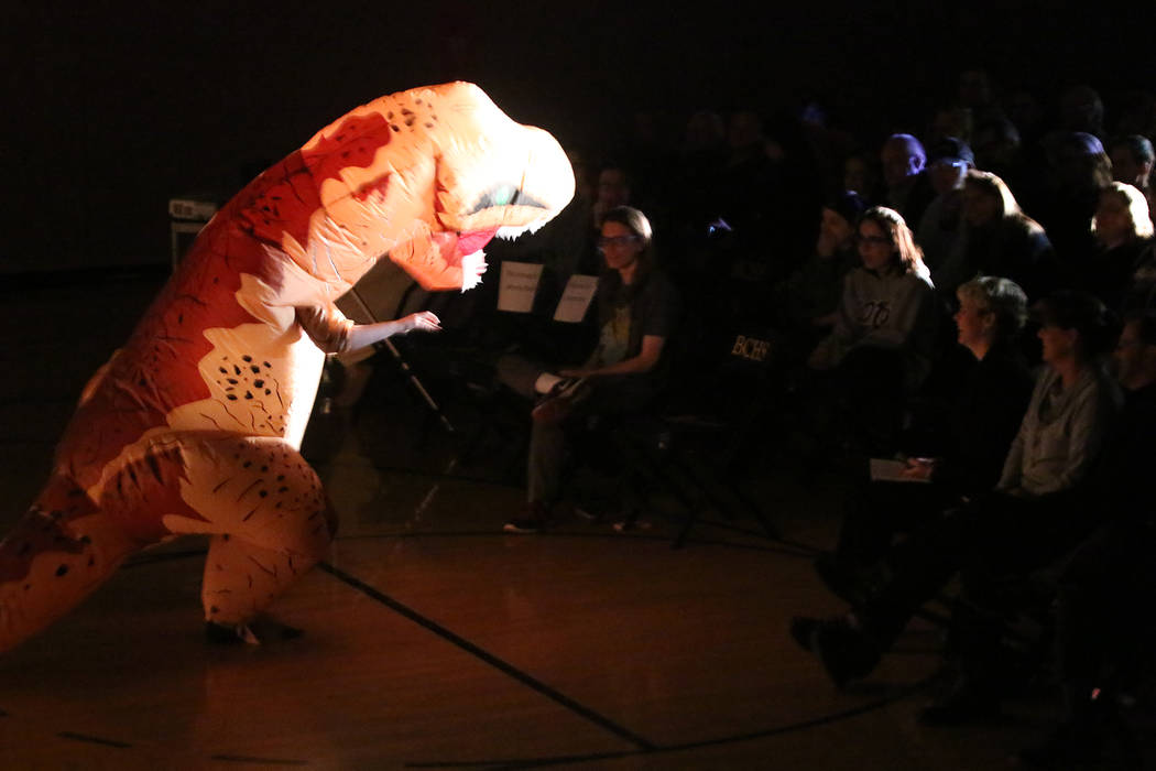 "BCHS Publications Jayme Sileo, who presented the award for best sound, enters the fifth annual Boulder City Movie Awards at Boulder City High School dressed as a Tyrannasaurus Rex from ""J ..."