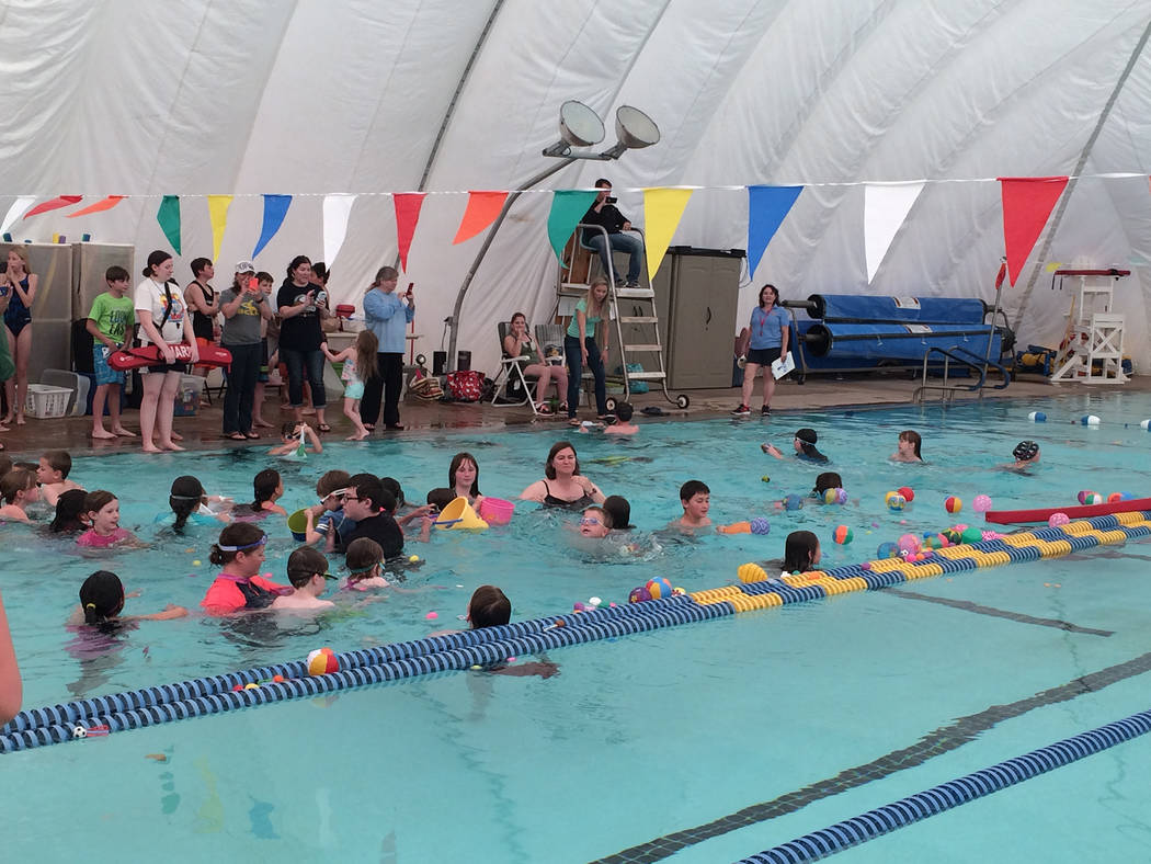 Hali Bernstein Saylor/Boulder City Review The number of children participating in the second annual Easter pool plunge, an egg hunt in the water, Saturday at the Boulder City Municipal Pool triple ...