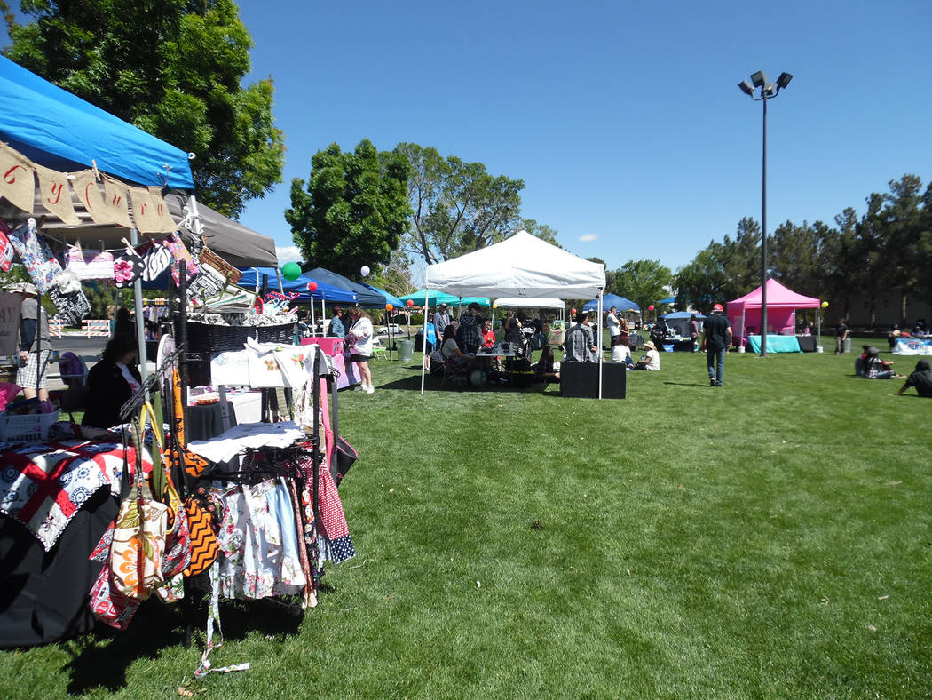 Hali Bernstein Saylor/Boulder City Review Community residents gathered in Bicentennial Park on Saturday to shop, eat and enjoy musical entertainment as part of Pride in Purity's Old School Block P ...