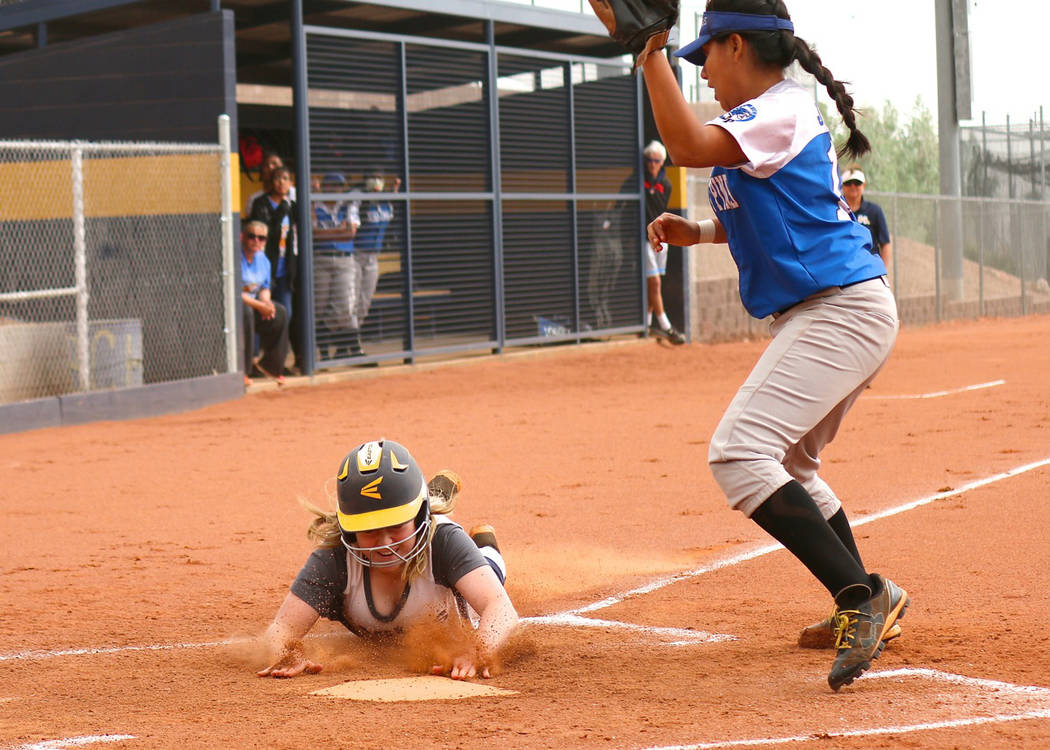 Laura Hubel/Boulder City Review In the dust storm, a great read by senior Alea Lehr on a passed ball brings in another run for the Lady Eagles softball team just under the tag against Desert Pines ...