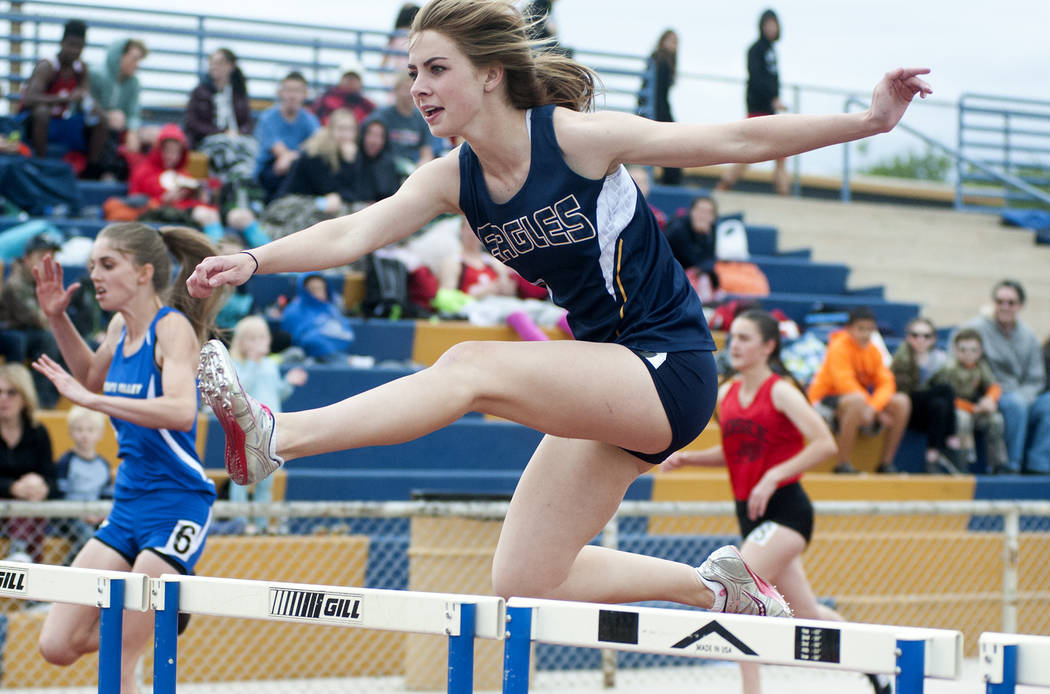 Steve Andrascik/Boulder City Review Boulder City High School senior Kenadee Bailey clears a hurdle during the 100-meter competition at the Ron Resler Invitational on Friday. She finished fourth wi ...