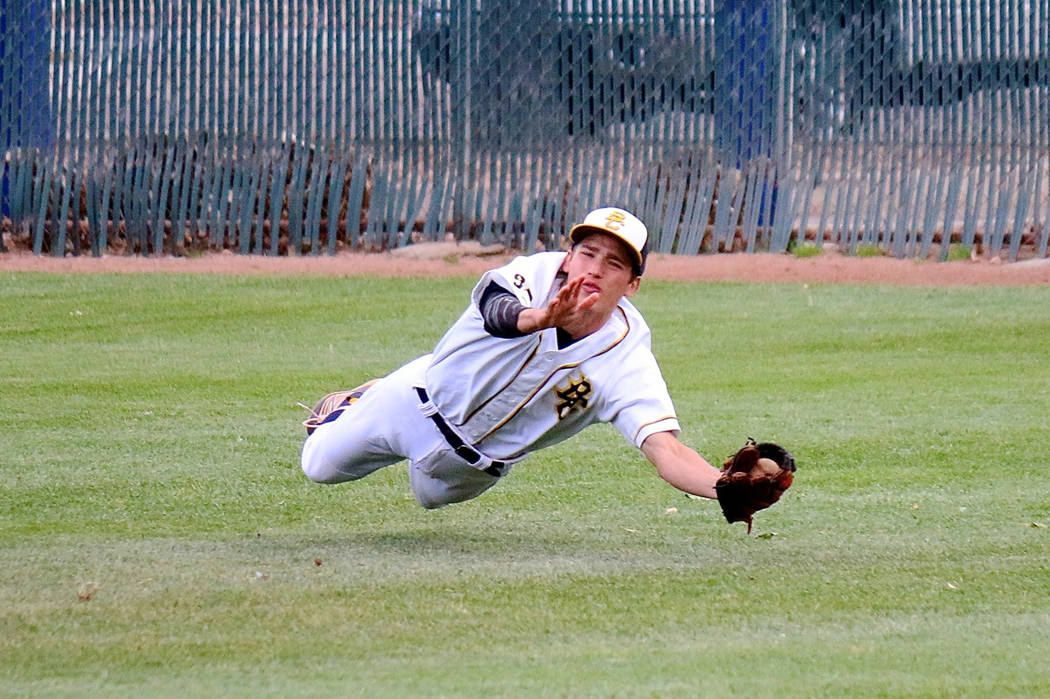 Laura Hubel/Boulder City Review A diving play in deep right field by Boulder City High School senior John Oliver ended the inning against Southeast Career Technical Academy during the Eagles' 6-2  ...