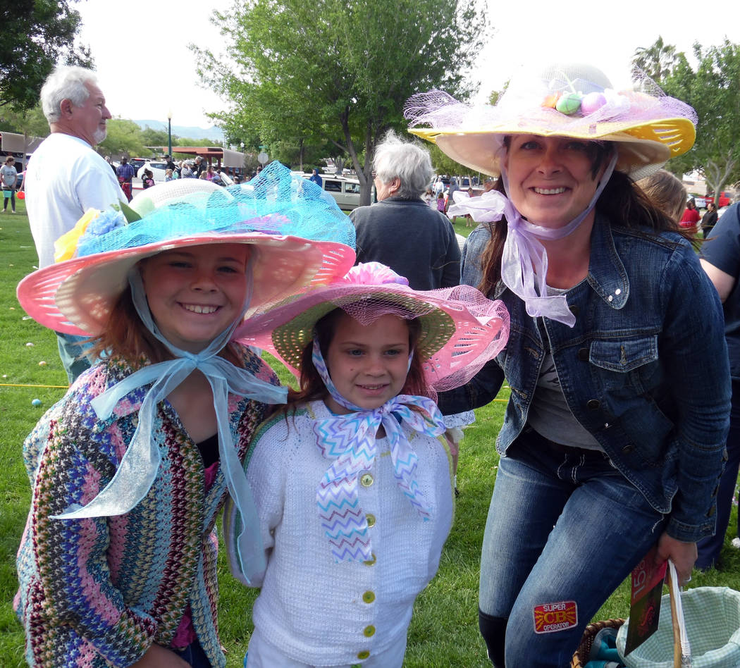 Hali Bernstein Saylor/Boulder City Review Millie, from left, Ellie and Andi Walker came to the 63rd annual Easter egg hunt on Saturday decked out in the colorful bonnets.