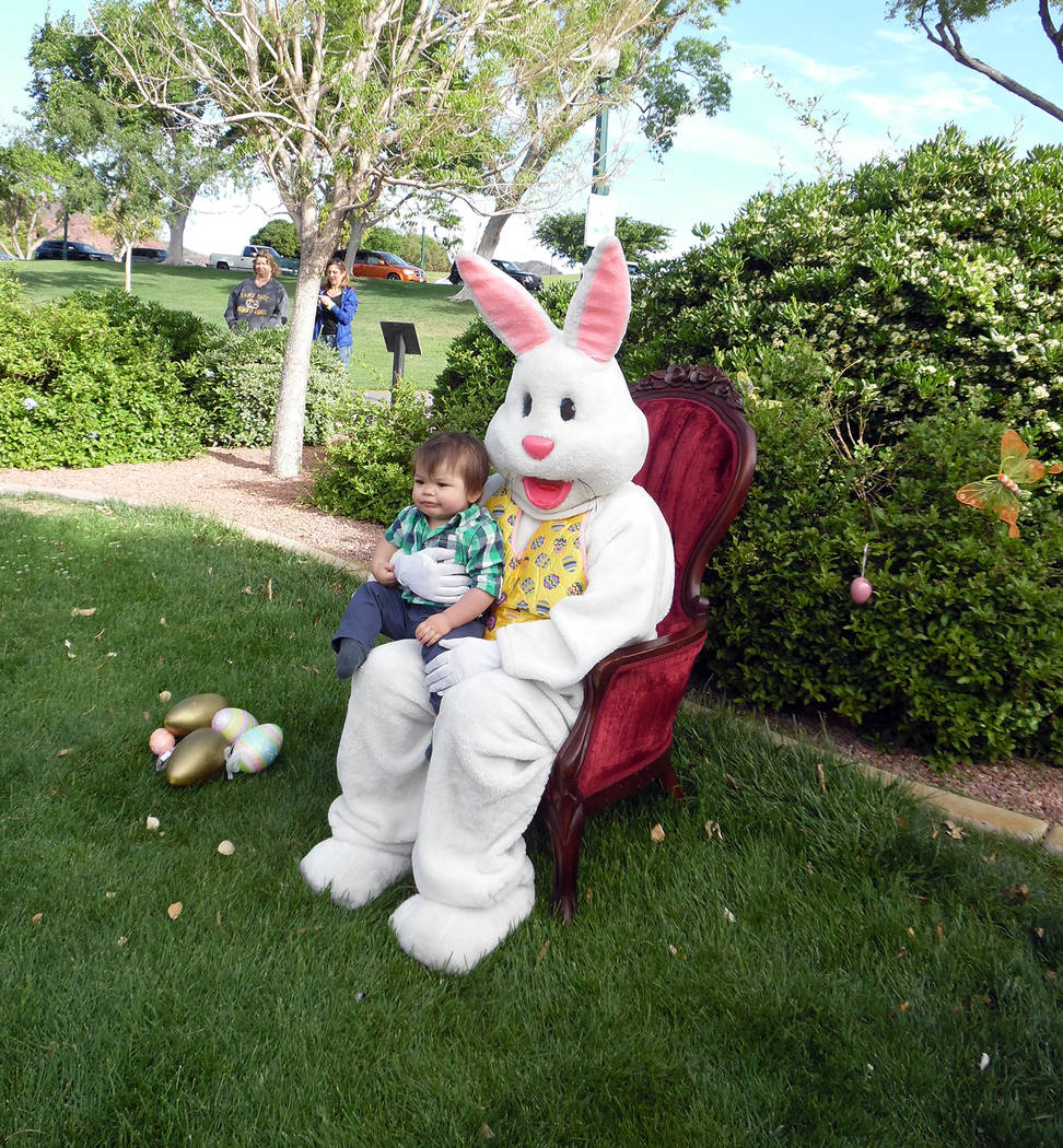 Hali Bernstein Saylor/Boulder City Review Oliver Gossard, 1, of Boulder City wasn't quite sure what to make of the Easter bunny as his family snapped pictures of him during Saturday's annual Easte ...
