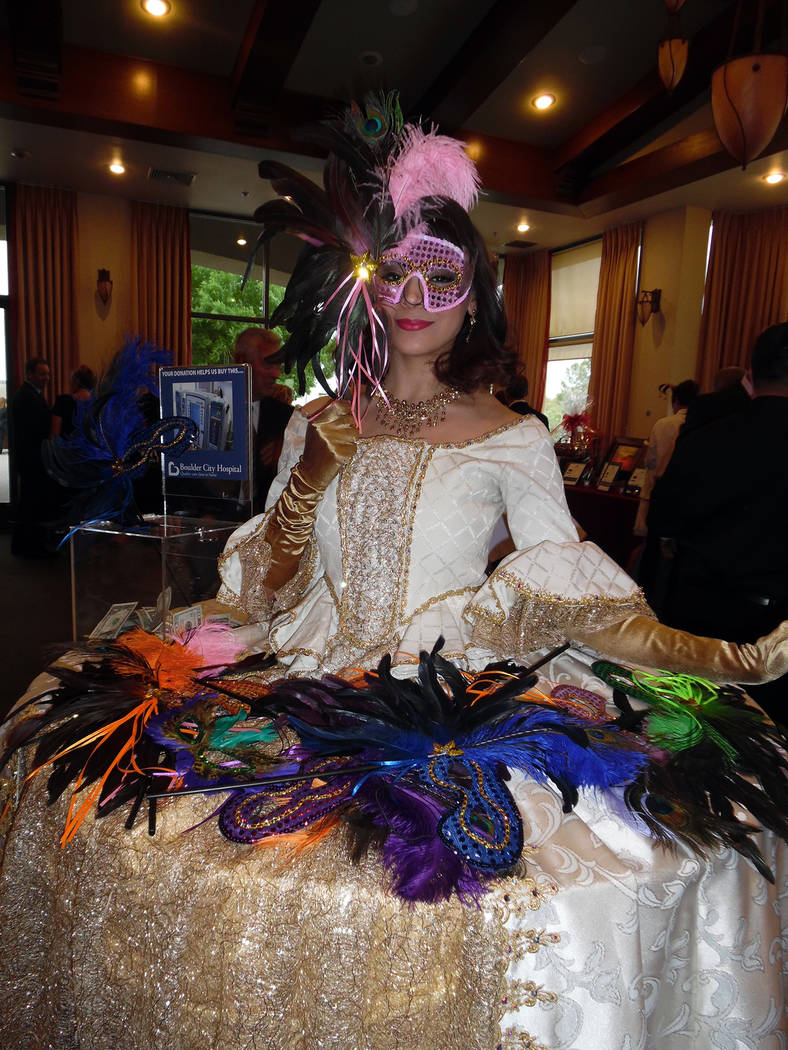 Hali Bernstein Saylor/Boulder City Review Tala Marie of Farrington Productions offered an assortment of masks for those attending Friday's masquerade-themed Heart of the Community Gala to benefit  ...