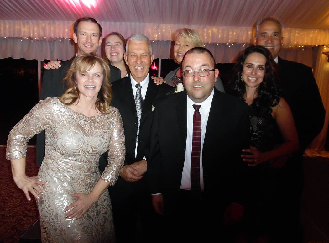 Hali Bernstein Saylor/Boulder City Review Mike and Teresa Giroux, center, were surrounded by family, from left, Vivian Harrison, Ken Vick, Elicia Giroux, Andy Giroux, Nikki Nicholl and Jeff Nichol ...