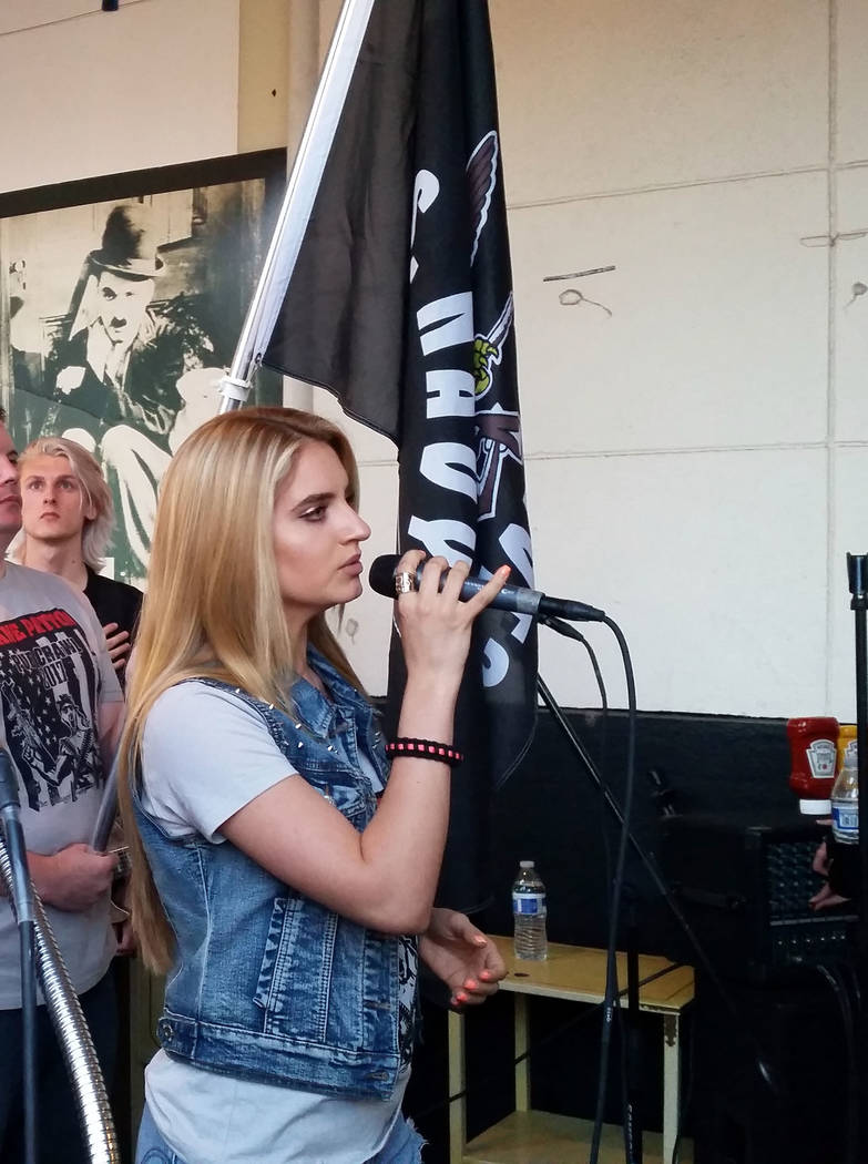 Celia Shortt Goodyear/Boulder City Review Siena Paglia sings the national anthem at the start of the Shane Patton Pub Crawl on Saturday.