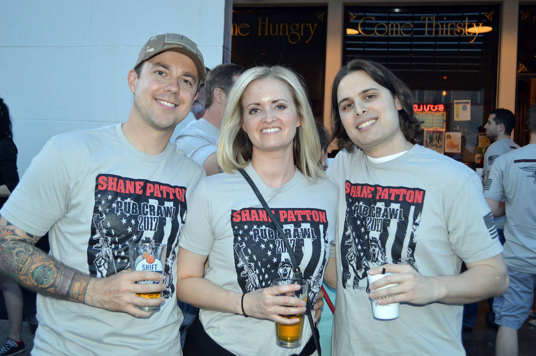 Celia Shortt Goodyear/Boulder City Review Mike Kenny, from left, Sarah Yeaton and Ryan Ward enjoy the Shane Patton Pub Crawl 2017.  They came from Las Vegas and Henderson for the event.