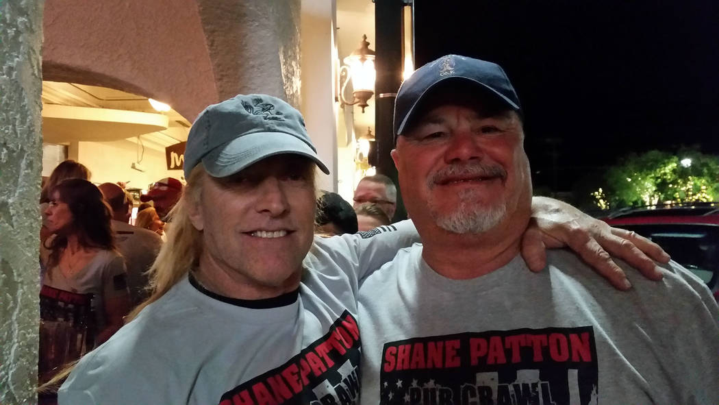 "Celia Shortt Goodyear/Boulder City Review James ""JJ"" Patton, father of the late Shane Patton, catches up with John Latham at the pub crawl. Patton and Latham did their U.S. Navy SEAL training toge ..."