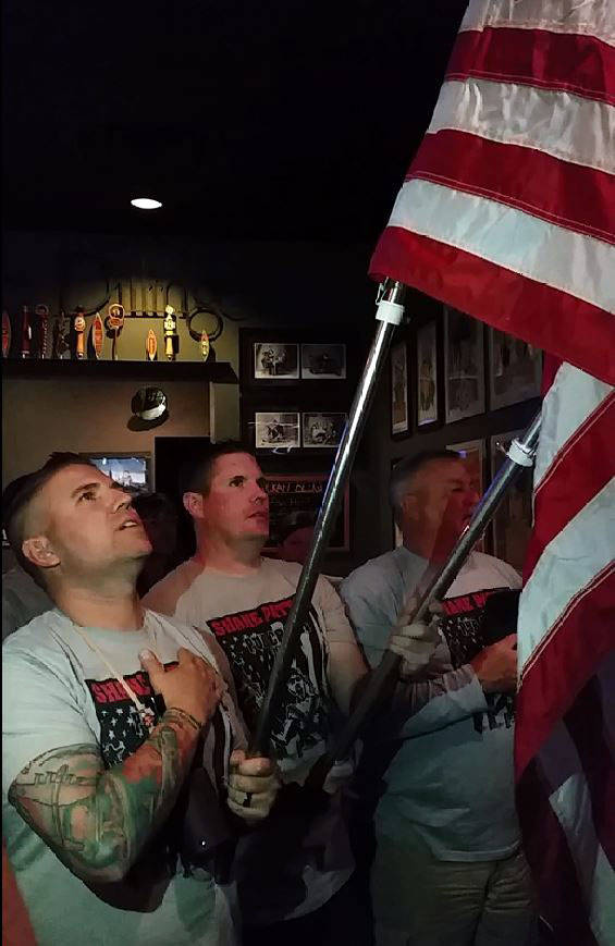 Celia Shortt Goodyear/Boulder City Review The 2017 Shane Patton Pub Crawl kicks off at The Dillinger with the Pledge of Allegiance led by, from left, Jevan Dixon, Brandon Tretton and John Latham.