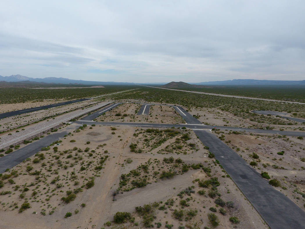 Michael Quine/Las Vegas Review-Journal @Vegas88s This aerial view shows the Searchlight airport, where Jonathan Daniels, founder of Praxis Aerospace Concepts International, plans to open a drone t ...