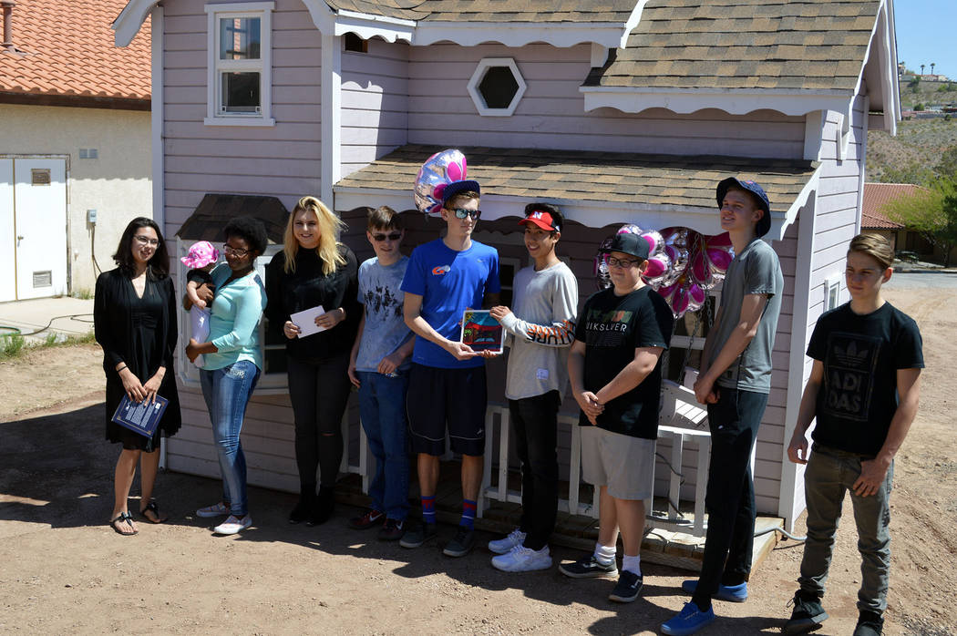Celia Shortt Goodyear/Boulder City Review Residents of St. Jude's Ranch in Boulder City present Teens Helping Teens with a commemorative plaque for their donation of a playhouse, from left, Diamon ...