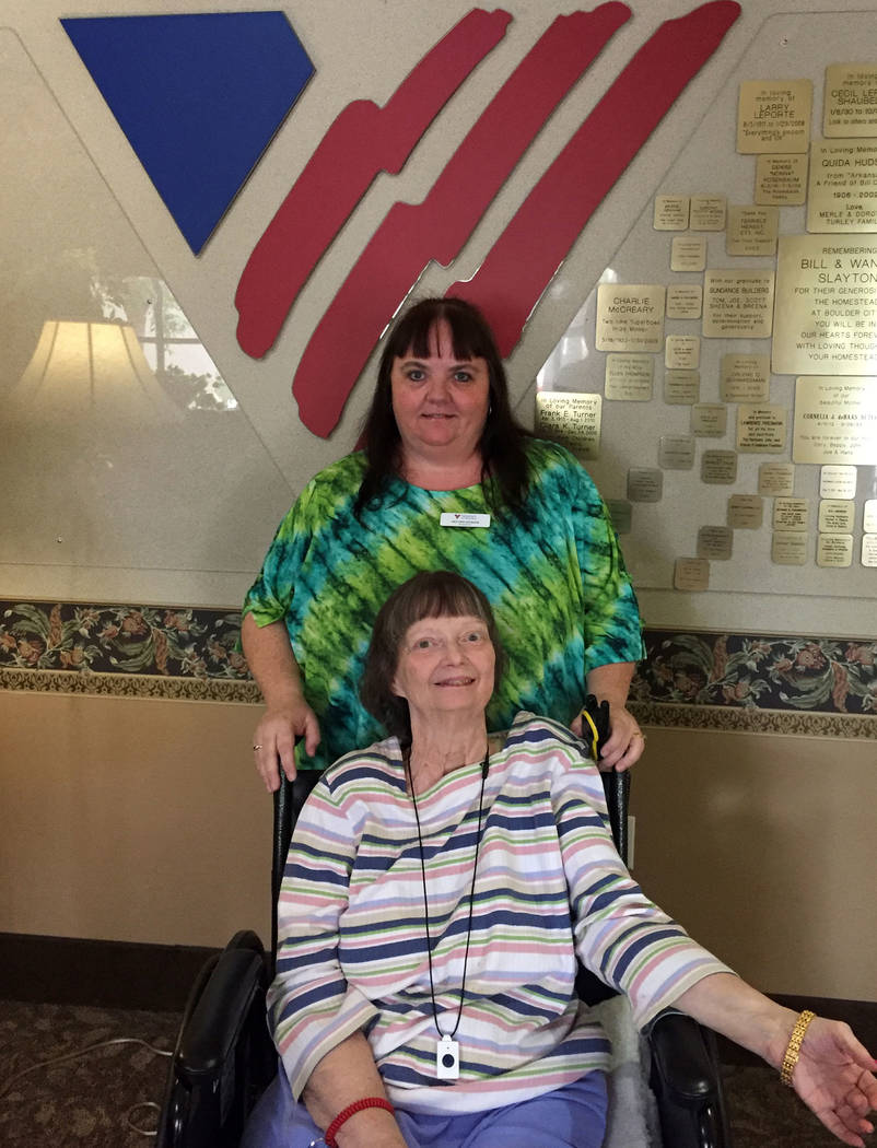 Tanya Vece Heather Seamans' quick thinking recently helped save the life of Arlene Clayton's husband, Ben. Clayton, seated, is a resident at The Homestead at Boulder City, and Seamans has worked t ...