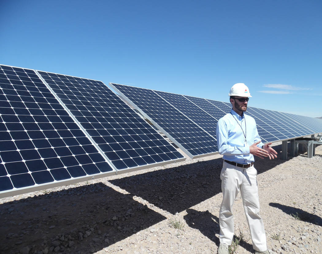 Hali Bernstein Saylor/Boulder City Review Andew deRussy, an engineer with Southern Power's engineering and maintenance team, explains how energy is generated on each module on the solar panel duri ...