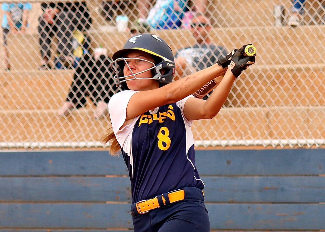 Laura Hubel/Boulder City Review Boulder City High School freshman Ashley Wishard watches a high fly to left field in the game against Del Sol on Monday. Her three-run double started a 13-run innin ...