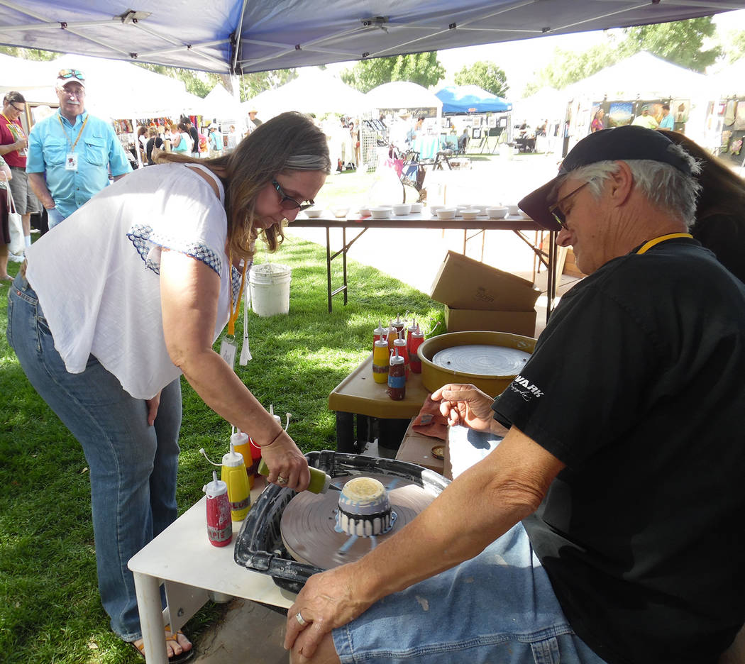 Hali Bernstein Saylor/Boulder City Review Shelly Thornhill of Las Vegas creates a spinner bowl as Craig Corey, who teaches ceramics at the Boulder City Parks and Recreation Department's art center ...