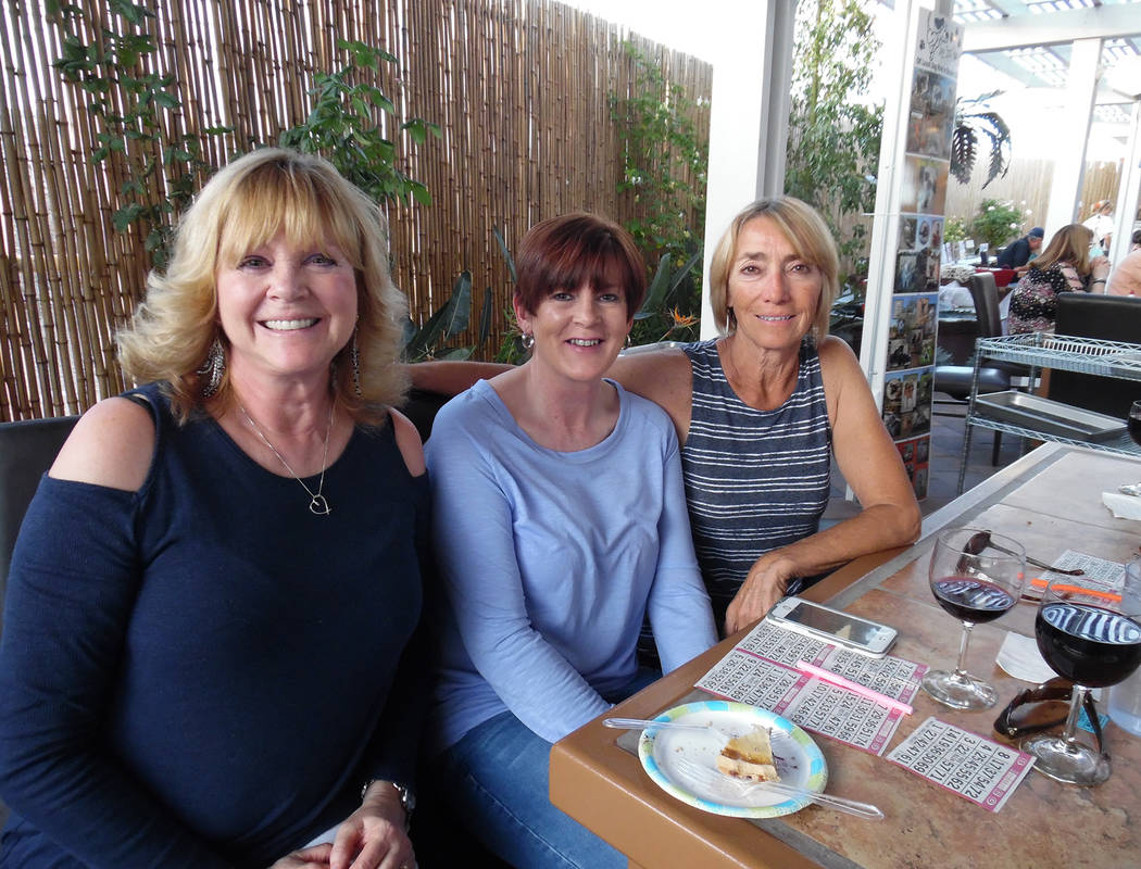 Hali Bernstein Saylor/Boulder City Review Ann Inabnitt, center, supervisor of the Boulder City Animal Shelter, visits with volunteers, Donna Schweitzer, left, and Yolanta Jonynas during Saturday's ...
